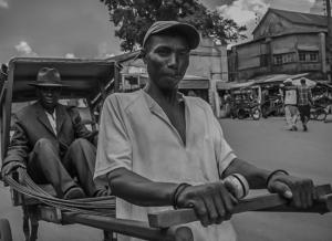 Pousse-pousse driver and passenger, Madagascar